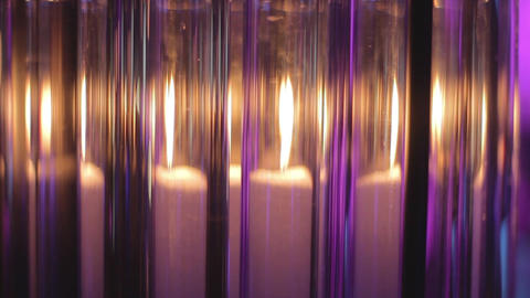 Candle shines beautifully through glass flasks Footage
