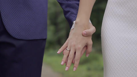 Newlyweds with rings on fingers holding hands Footage