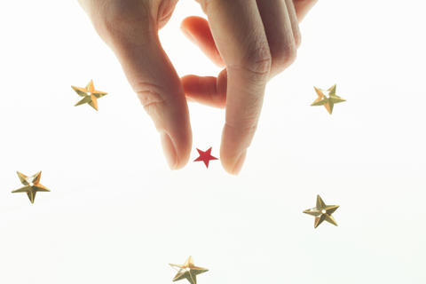 all in your hands and stars hand in the sky takes a star フォト