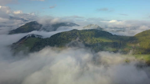 Aerial panoramic view above mist clouds in magic country landscape at morning Footage
