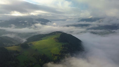 Aerial foggy country landscape in morning light above clouds with beautiful Footage