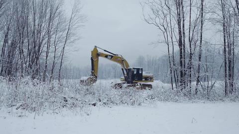 BIALKA TATRZANSKA, POLAND - FEBRUARY 3, 2018. Caterpillar CAT crawler excavator Footage