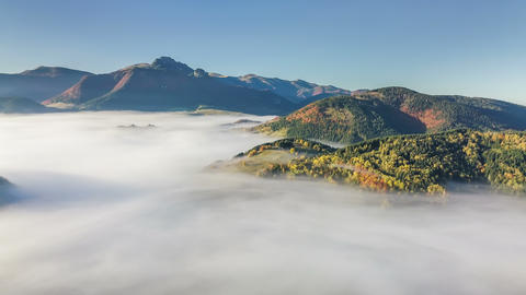 Aerial panoramic view above foggy landscape in autumn. Slow motion time lapse Footage