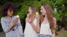 Cheerful women eating tasty ice cream Footage
