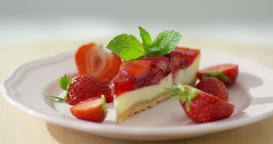 Strawberry cheesecake on plate Footage