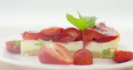 Strawberries and slice of cake Footage