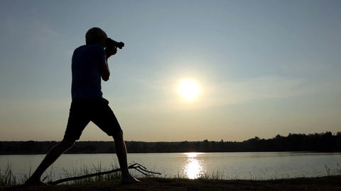 Cameraman shoots a splendid sunpath on a lake at sunset in slo-mo 영상물