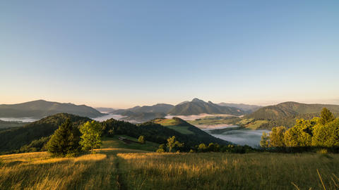 Sunrise in summer rural country. Fog in landscape valley time lapse dolly shot Footage