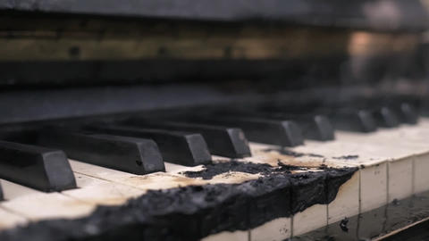 Scorched down to coal smoking piano keyboard Footage