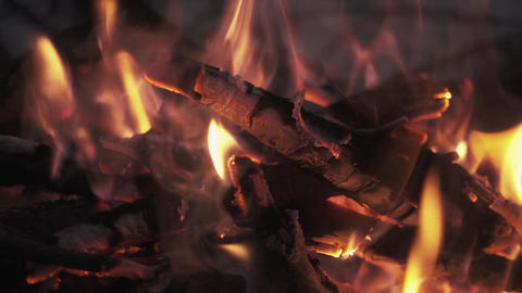 Firewood shaking burning flame in pile of campfire Footage
