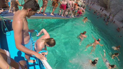 GREECE, ZAKYNTHOS AUGUST 2017: Kids and adults tourists swimming in the sea of Footage