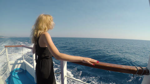 Happy young woman on cruise ship vacation traveling on sea smiling and admiring Footage