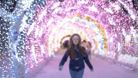 The girl joyfully runs and jumps. Smiling and laughing. Leaves the non-sharpness Footage
