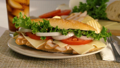 Sandwich Falling Onto A Plate In Slow Motion Live Action