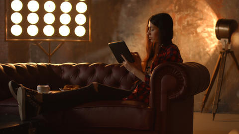 Freelance woman using tablet pc in loft interior Footage