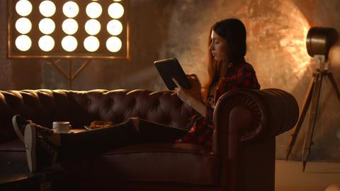 Freelance woman using tablet pc in loft interior 영상물