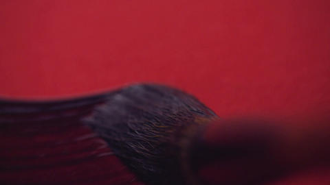 Chinese calligraphy. Writing on red paper Footage