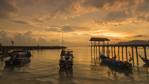 Timelapse of sunset with beautiful cloud at fisherman jetty Footage