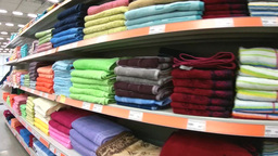 Shelves with bath towels in the supermarket Footage