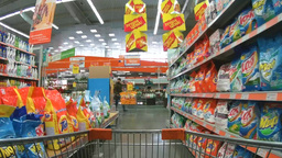Shopping trolley moving between shelves with washing powders in the supermarket Footage