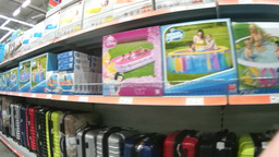 Shelves with products for recreation in the supermarket Footage
