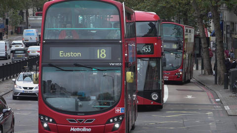 Street view with red busses in London - LONDON, ENGLAND Footage