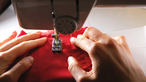 The tailor sews on a sewing machine, 4k Live Action