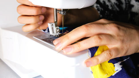 Woman sews on the sewing machine, 4k Live Action