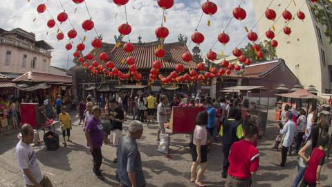 Chinese devotees burn joss sticks a large urn Footage