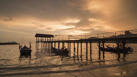 Timelapse of sunset at Fisherman jetty at Teluk Kumbar Footage