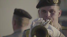 The performance of a military band. The trumpeter is playing on the trumpet Footage