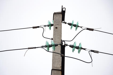 Glass Insulators on power lines Foto