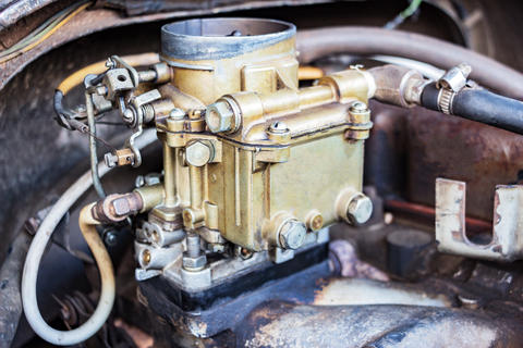 Vintage carb on the old engine Photo