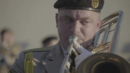 The trumpeter of a military orchestra plays on a trumpet Footage