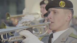 A man is playing trumpet in a military band Footage