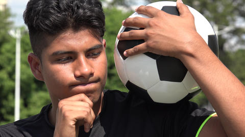 C0009 athletic teen male soccer player thinking deep thought Footage
