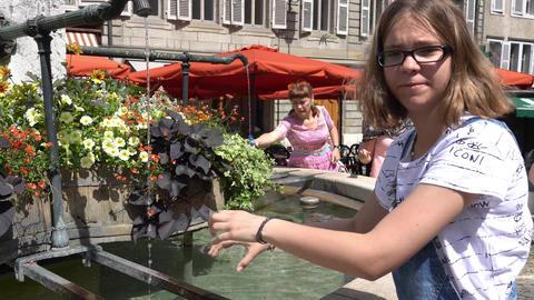 GENEVA, SWITZERLAND - JULY 06, 2017: City fountain with drinking water in Geneva Footage
