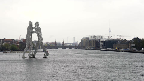 Statue of Molecule Man at the Spree river on a cloudy day in Berlin Footage