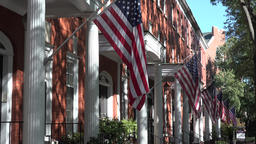 USA Virginia Norfolk row of house entrances with national flags Footage