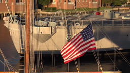USA Virginia Norfolk stars and stripes flag in flat evening sun Footage