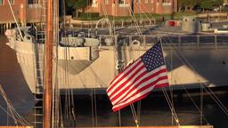 USA Virginia Norfolk stars and stripes flag in flat evening sun ビデオ