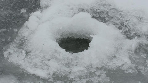 ice fishing hole closeup Footage