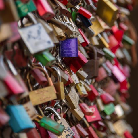 Many padlocks on a bridge Photo