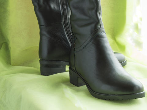 Pair of women's fashion black leather boots Photo