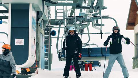 BIALKA TATRZANSKA, POLAND - FEBRUARY 4, 2018. People leaving alpine ski lift or Footage