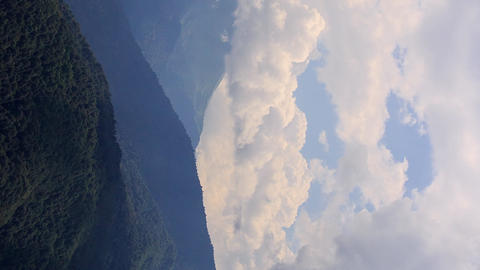 Vertical video. Clouds in the mountains. Time Lapse. Sochi, Russia Footage