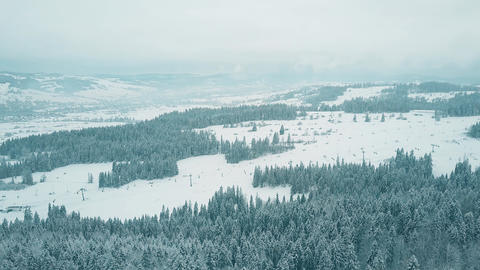 Aerial pan shot of a ski resort slopes in southern Poland, the Tatra mountains Footage
