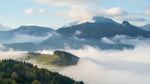 Foggy morning with wave of clouds in mountains valley landscape time lapse Footage