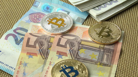 Bitcoins close-up on euro currency background. Golden bitcoin, blue bitcoin and 영상물