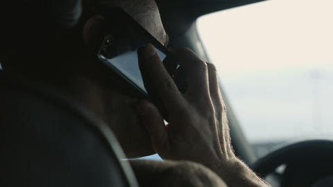 Bussines man speak by phone sitting in car Image